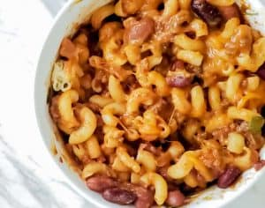 Sweet and Spicy Chili Mac in a white bowl on a marble counter top.