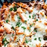 This Classic Baked Mostaccioli is perfect for a crowd, parties, and family meals! This recipe is my grandma's and is filled with ground beef, Italian sausage, mozzarella cheese, and the best marinara sauce! This easy baked pasta meal is ready in about 40 minutes and can be kept warm in a crockpot or slow cooker as a holiday, party, Thanksgiving or Christmas side! #pasta #bakedpasta #comfortfood #familymeal #holidayside #mostaccioli #homemade #maindish #dinnerrecipe #sidedish
