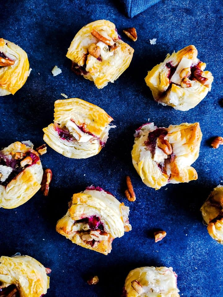 These Blackberry Brie Bites with Pecan Sage topping are the best simple, fast holiday appetizer recipe. Ready in 20 minutes and easy to hold size makes this Thanksgiving and Christmas recipe the best. #appetizer #recipe #holidays #Thanksgiving #Christmas
