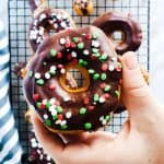 This Chocolate Glazed Donut Recipe is easy and ready in 15 minutes! They are fried using Pillsbury Grands Biscuits and topped with dark chocolate and sprinkles. The perfect treat for parties, holidays, families, Christmas morning breakfast or brunch for kids and adults. Enjoy this fun sweet recipe! #sweets #donuts #holidays #Christmas