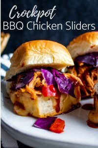"Pin Image for Crockpot Hawaiian BBQ Chicken Sliders. Image shows a close up, strait on shot of one of the sliders. On the top in white text are the words, ""Crockpot BBQ Chicken Sliders."