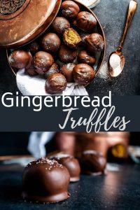 "Pin for gingerbread truffles recipe. In the center in white text is the words ""Gingerbread Truffles"". The top image shows an above shot of the truffles in a copper tin. The bottom photo shows a strait on shot of the gingerbread truffles. The one in front is in focus and the ones in the background are out of focus."