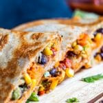 These Vegetarian Quesadillas are the perfect quick 30 minute, one pan dinner or lunch recipe. Filled with sweet potato, black beans, avocado, corn, peppers and cheese these are super tasty and healthy. Perfect for both kids and adults! #erhardtseat #Vegetarian #30minutemeal #onepan #Mexican #Quesadillas