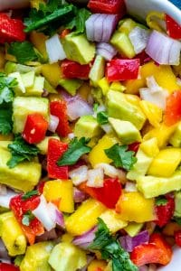 Close up of salsa chopped in bowl.