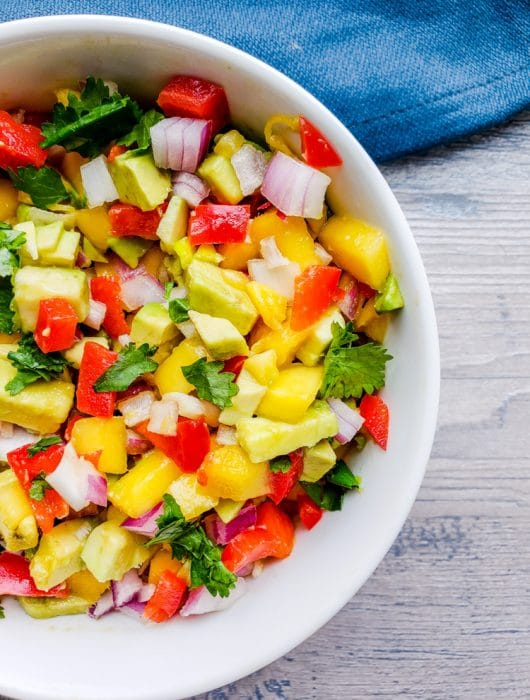 This Easy Mango Avocado Salsa is the BEST fresh summer salsa made with mango, avocado, cilantro, red onion and red pepper. Perfect on its own with chips or paired with your favorite Mexican food like tacos! #salsa #healthy #vegan #vegetarian