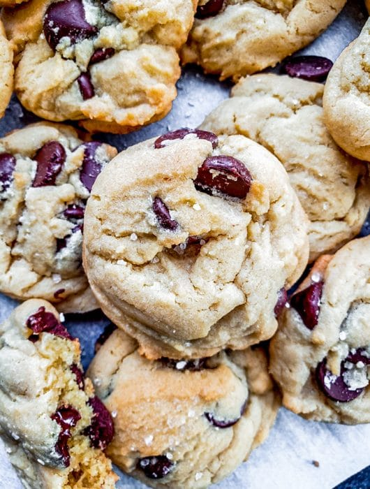 This Salted Chocolate Chip Cookie recipe is the best treat for any occasion including holidays, birthdays, or for a school treat. Packed with dark chocolate chips and topped with a hint of sea salt these cookies are easy and require no chilling. #baking #desserts #cookies