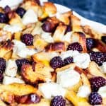 This Overnight Baked Cinnamon French Toast Casserole with blackberries and cream cheese is the best easy recipe for brunch or breakfast for a crowd! Perfect for holidays, parties, Thanksgiving, Christmas, or a weekend treat for the family. Make ahead of time for simple prep freezer friendly! {VIDEO} #breakfast #FrenchToast #Blackberries #MakeAheadMeal
