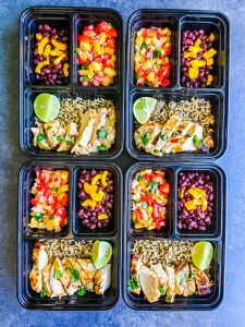 Meal prep image showing Cilantro Lime Grilled Chicken in four rectangular bowls with sides.