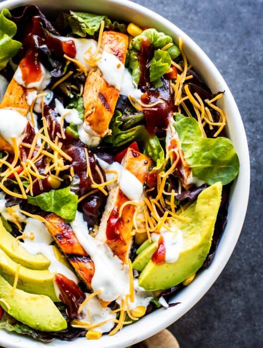 This Grilled BBQ Chicken Salad with Homemade Buttermilk Ranch Dressing is the best summer grill recipe for friends and family! This healthy meal is tasty, a little spicy and works great as a side dish or main dish. Add your favorite toppings like avocados, cheese, black beans, corn, egg, or tomatoes for the perfect touch! Don't have a grill? No problem you can make the chicken on the stove top as well! #salad #BBQ #chicken #recipe #food #healthy #under30minutemeal