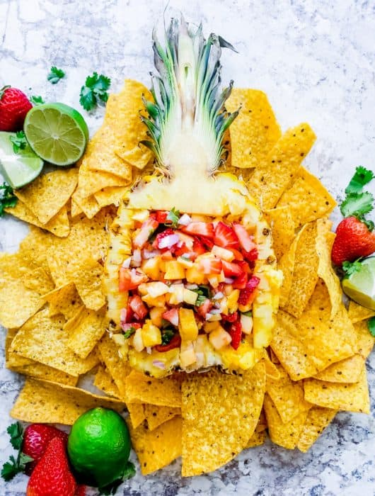 This vegan Strawberry Pineapple Salsa recipe is super healthy, fast and required no cooking! This fresh appetizer is the best for summer BBQ's, holidays, 4th of July, Labor Day or just a gathering with friends and family. #salsa #fruit #strawberries #easyrecipe #vegan