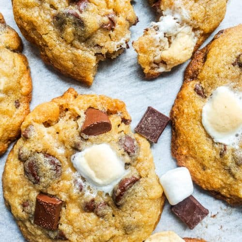 This Easy Chewy S'mores Cookies Recipe is the best twist on the classic summer campfire favorite! This recipe can be made ahead of time and is the perfect dessert for kids, families or to share with friends. Chocolate, marshmallows, and graham crackers just got better!