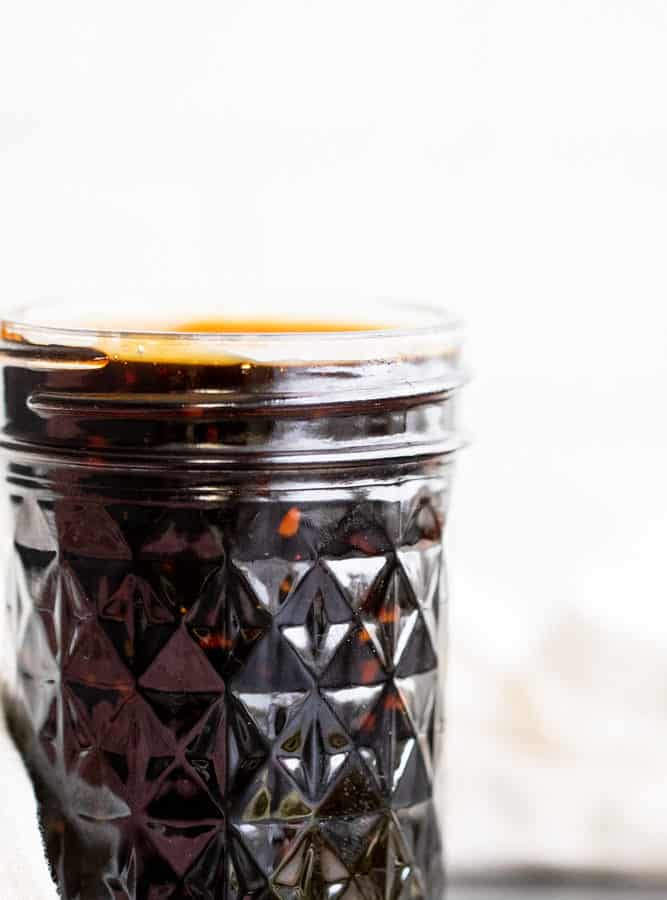 Teriyaki sauce in a glass mason jar.