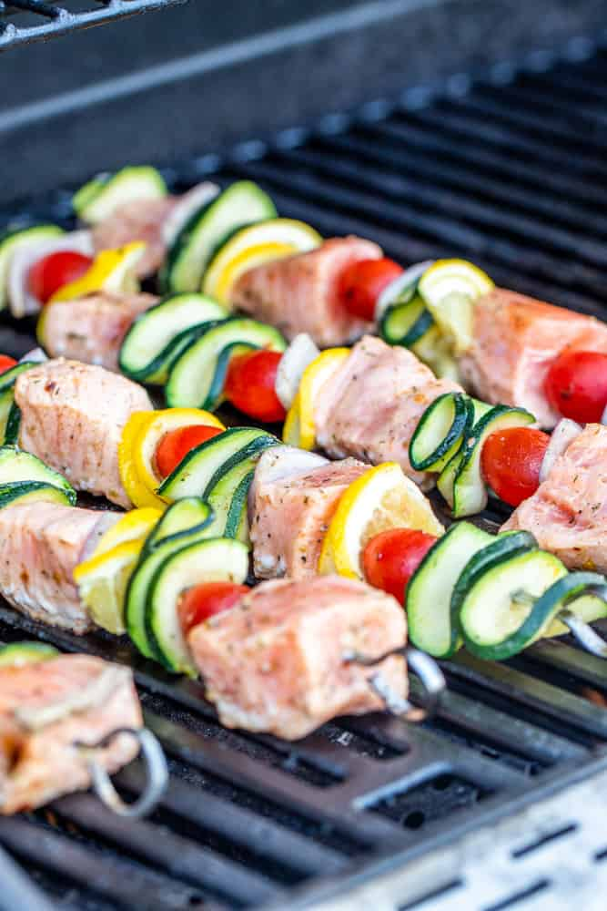 Skewers cooking on an outdoor grill.