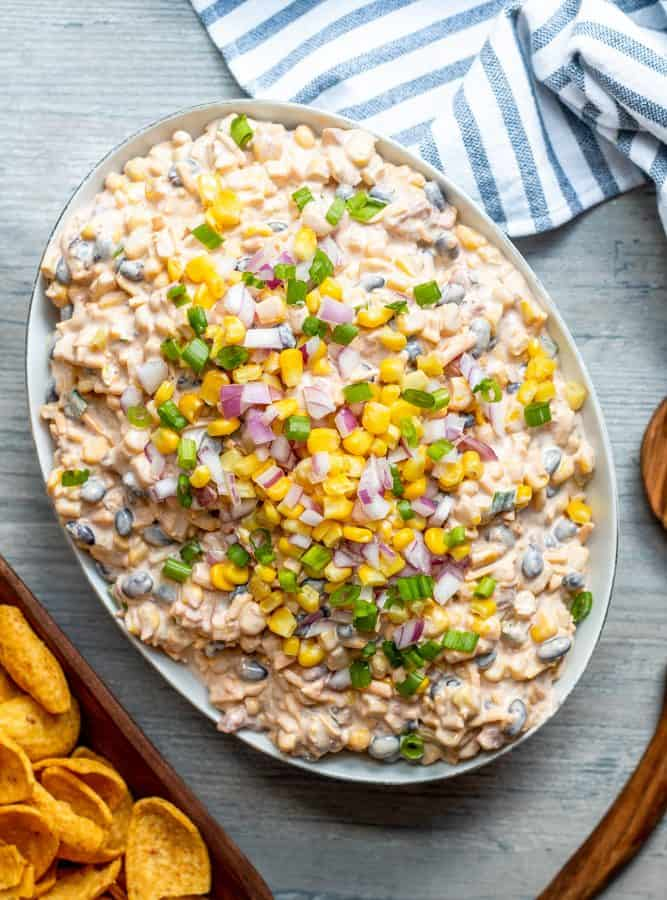 Overhead shot of white bowl of corn dip,