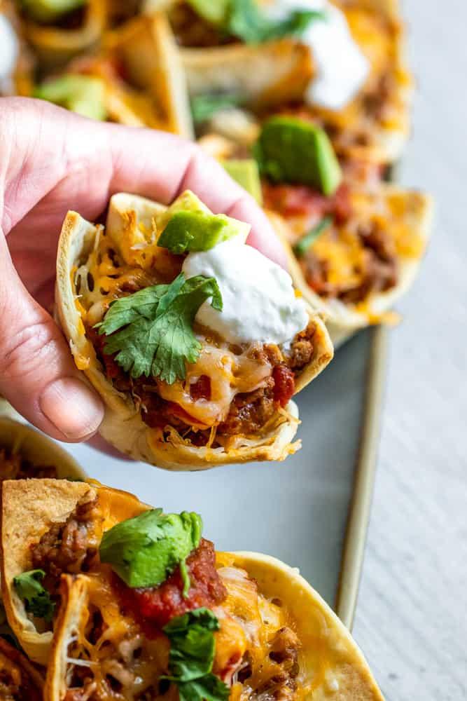 Hand picking up mini taco.