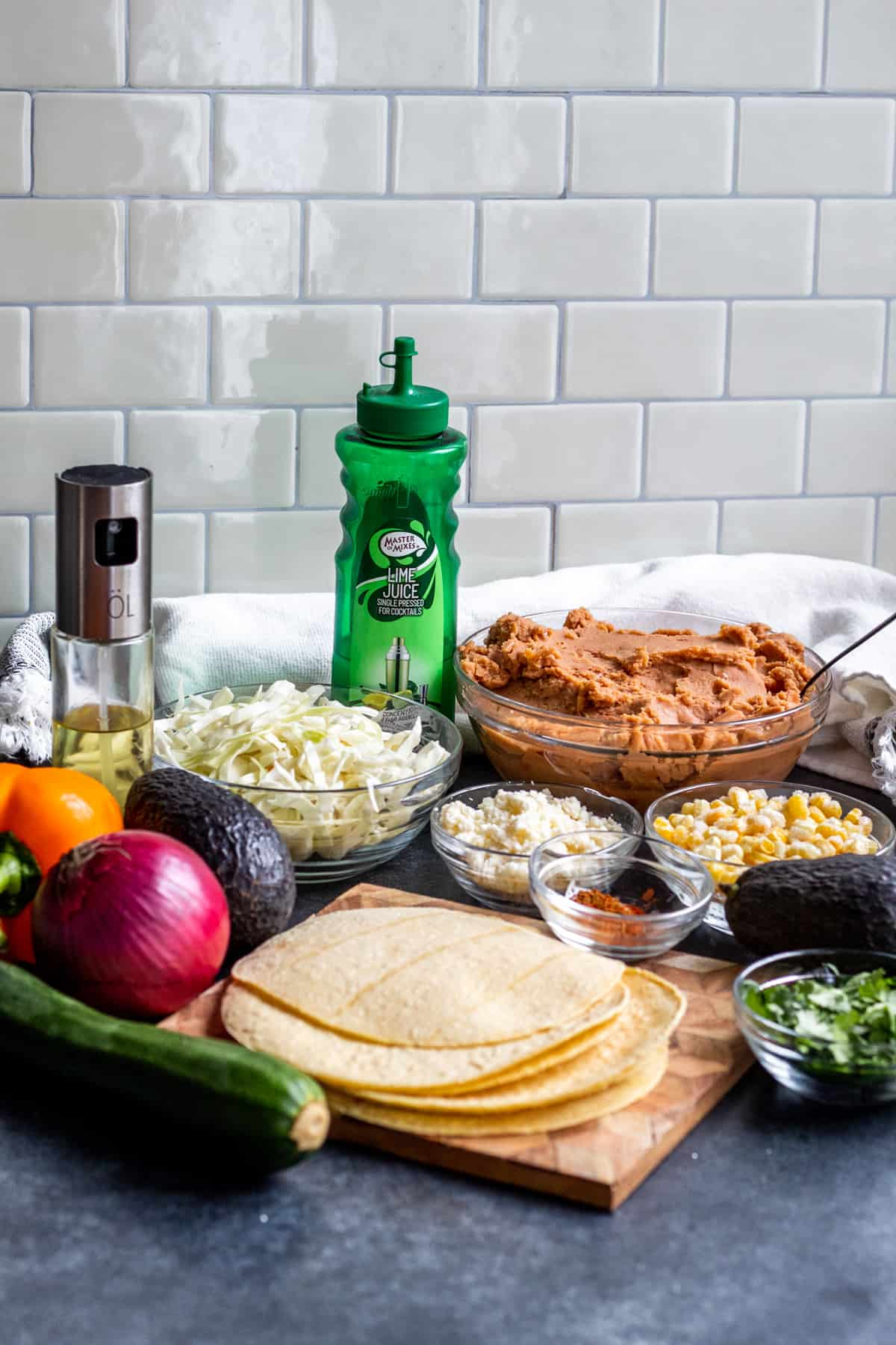 Tostada ingredients laid out on blue counter.